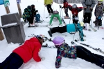 heather-mcphie-doing-pushups-with-the Moonlight-Basin-Freeride-Team-at-Moonlight-Basin-Big-Sky-Montana
